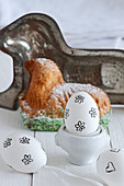 White egg decorated with black stamped motif