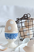 Blown egg decorated with white spots