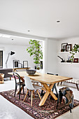 Wooden table with various chair in dining area