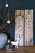 Christmas pictures drawn on wooden boards