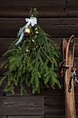 Christmas arrangement of spruce branches on rustic wooden wall