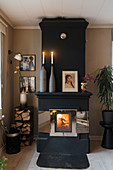 Fire in black stove in living room
