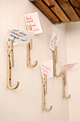 Coat pegs made from wooden clothes pegs holding positive mottoes