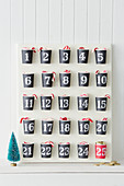 Advent calendar handmade from paper cups with numbered stickers