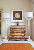 Baroque chest of drawers between two classic standard lamps