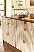 Drawers with leather pulls in rustic fitted kitchen