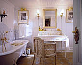 Vintage furniture in classic white and gold bathroom