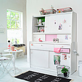 Renovated, pink-and-white 50s dresser