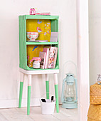 Shelves handmade from fruit crate and stool