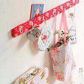 Row of hooks upholstered in floral fabric