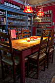 Wooden table, chairs and shelving in dining room