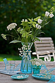 Queen Anne's lace and phlox in blue vase on terrace table