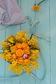 Small arrangement of mimosa and ranunculus