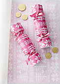 Handmade crackers made from pink paper with cross-stitch pattern