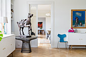 Horse sculpture on round metal table in classic living room