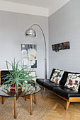Arc lamp above retro seating area in living room