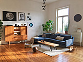 Sunny living room in mid-century style with wooden floor