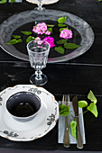 Floating flowers in dish on table set in vintage style