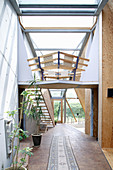 Wooden staircase in open-plan interior of architect-designed house
