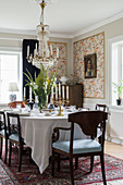 Set dining table and dark chairs in classic dining room
