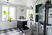 Classic, black-and-white bathroom with chequered floor