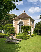 Old stone house in summery, English-style garden