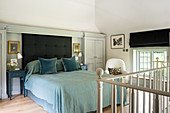 Blue bed in classic bedroom on gallery
