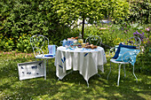Table set for Easter breakfast in garden