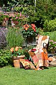 Patchwork blanket in shades of orange on chair in sunny garden