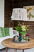 Basket used as pendant lampshade above coffee table in living room