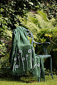 Green blanket hand-decorated with sequinned fern motifs