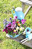 Violas and pansies planted in blue bundt cake tin