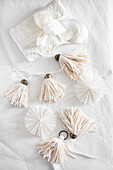 Handmade tassels, paper rosettes and wrapped gift