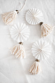 White, handmade tassels and paper rosettes