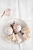 White, handmade tassels and Christmas-tree baubles