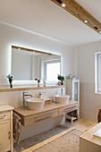 Backlit mirror in beige, modern bathroom