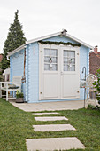 Pale blue, Scandinavian-style summer house with wintry decorations