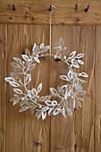 Handmade wintry wreath of paper leaves