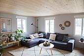 Grey corner sofa in Scandinavian-style living room