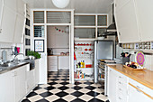 Retro kitchen with chequered floor and partition wall