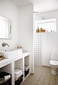 Masonry washstand in white bathroom