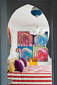 Oriental doorway leading into brightly decorated bedroom