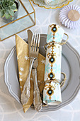Handmade crackers on place setting
