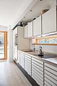 Pale fitted kitchen