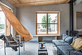 Wafting curtain in rustic living room in earthy shades