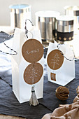 Handmade paper gift bags with round tags and tassels for Christmas