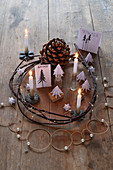 Original Advent wreath with miniature paper fir trees in white and natural shades