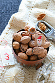 Gifts for St. Nicholas' day: walnuts in copper cake tin on hand-crocheted blanket