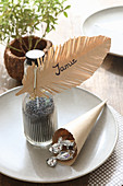 Table decoration with handmade paper feather as name tag