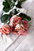 Bunch of roses tied with lace ribbon